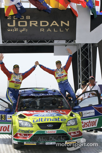 Podium: rally winners Mikko Hirvonen and Jarmo Lehtinen celebrate