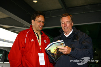 IU basketball coach, Tom Crean, gets an autograph from Johnny Rutherford