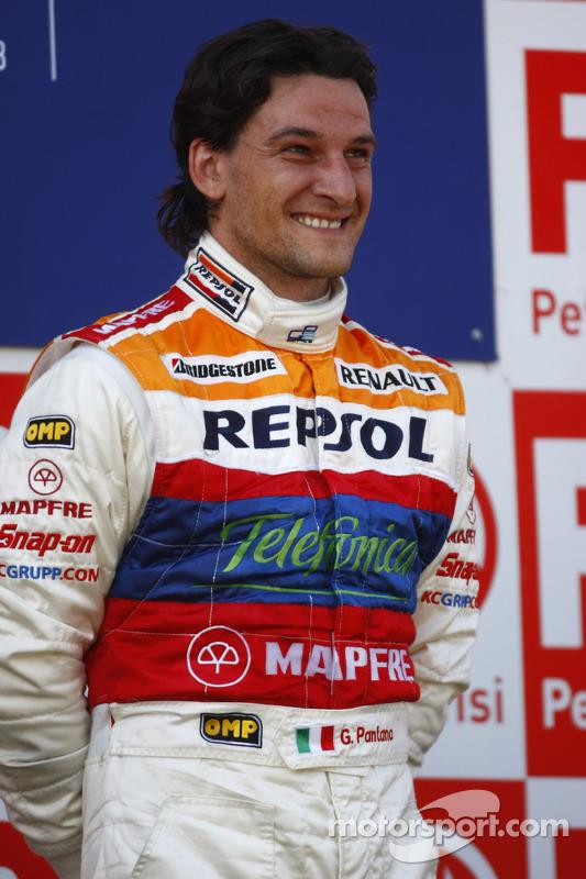 Giorgio Pantano celebrates victory on the podium