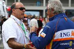 Muhtar Kent, Coca Cola Company COO with Bernie Ecclestone, President and CEO of Formula One Management and Flavio Briatore, Renault F1 Team, Team Chief, Managing Director