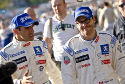 Race winners Marc Gene and Jacques Villeneuve head to the podium