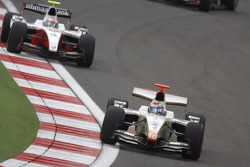 Vitaly Petrov leads Romain Grosjean