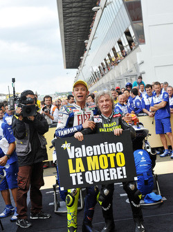 Race winner Valentino Rossi celebrates his 90th career victory with Angel Nieto