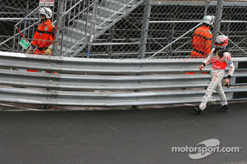 Heikki Kovalainen, McLaren Mercedes walking back to the pits after crashing out