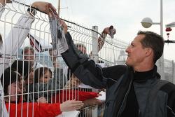 Michael Schumacher, Test Driver, Scuderia Ferrari, signs autographs