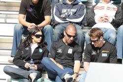 Danica Patrick, Tony Kanaan, and Marco Andretti looking at Tony's shoe