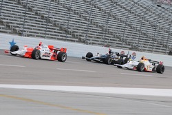 Helio Castroneves, Mario Dominguez, and Dan Wheldon running together