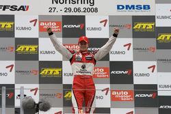 Podium: race winner Nico Hulkenberg celebrates