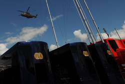 A Military Helicopter flies over the paddock