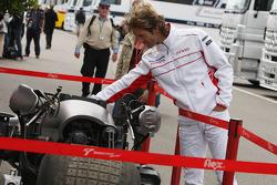 Jarno Trulli, Toyota Racing, looks at the batpod