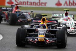 Mark Webber, Red Bull Racing leads Rubens Barrichello, Honda Racing F1 Team