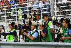 Photographers await the podium ceremony