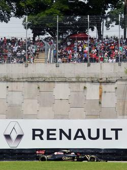 Romain Grosjean, Lotus F1 E23 passes a Renault advertising hoarding