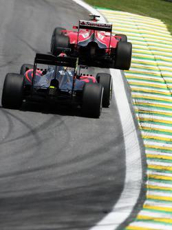 Kimi Raikkonen, Ferrari SF15-T leads Fernando Alonso, McLaren MP4-30