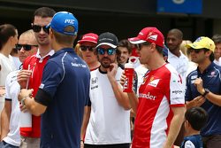 (L to R): Fernando Alonso, McLaren with Sebastian Vettel, Ferrari on the drivers parade
