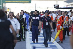 Mechanics in the pit lane