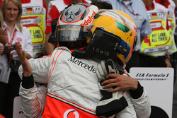 Pole winner Lewis Hamilton celebrates with Heikki Kovalainen