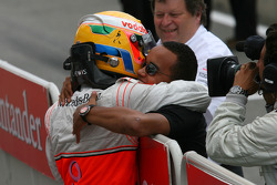 Race winner Lewis Hamilton celebrates with brother Nick