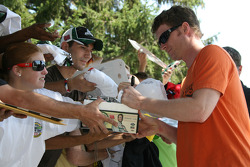 Dale Earnhardt Jr. signs autographs