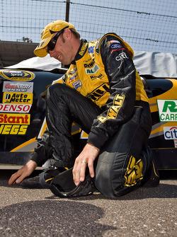 Matt Kenseth inspects the track