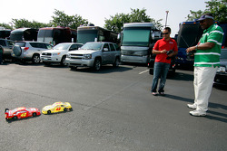 Juan Pablo Montoya and Gary Graves of USA Today, race remote control cars in the driver's lot