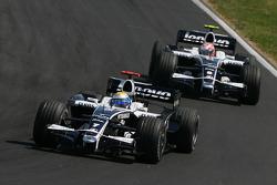 Nico Rosberg, WilliamsF1 Team, FW30 and Kazuki Nakajima, Williams F1 Team, FW30