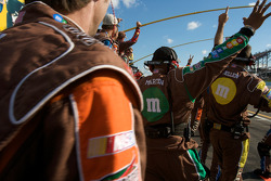 M&M's Toyota crew members celebrate as Kyle Busch takes the checkered flag