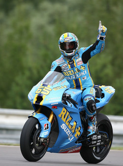Third place Loris Capirossi celebrates