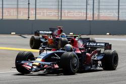 Sebastian Vettel, Scuderia Toro Rosso, STR03 leads Sébastien Bourdais, Scuderia Toro Rosso, STR03