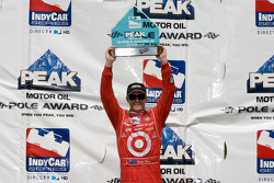 Pole winner Scott Dixon with the pole award trophy