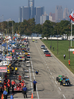 IndyCar teams take the cars back to the paddock at the end of the practice session