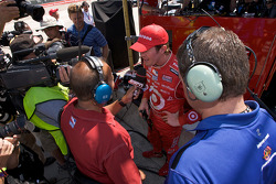 Pole winner Scott Dixon gives interviews