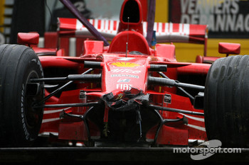 The wrecked Ferrari of Kimi Raikkonen after his crash in the last lap