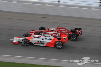 Helio Castroneves and Dan Wheldon run together