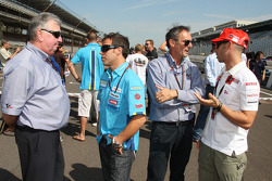 Loris Capirossi and Marco Melandri with FIM Safety Director Claude Danis and 1982 500cc World Champion Franco Uncini