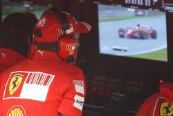 Michael Schumacher, Test Driver, Scuderia Ferrari watches Felipe Massa, Scuderia Ferrari on the TV Monitor