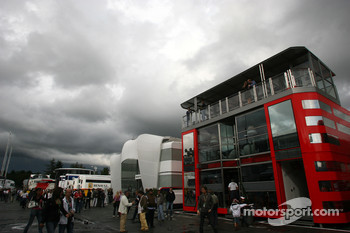 Dark clouds hang over the paddock