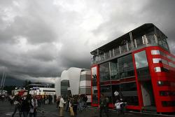 Dark clouds hang over the paddock