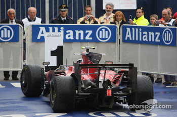 Race winner Sebastian Vettel arrives in Parc Fermé