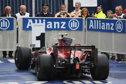Race winner Sebastian Vettel arrives in Parc Fermé
