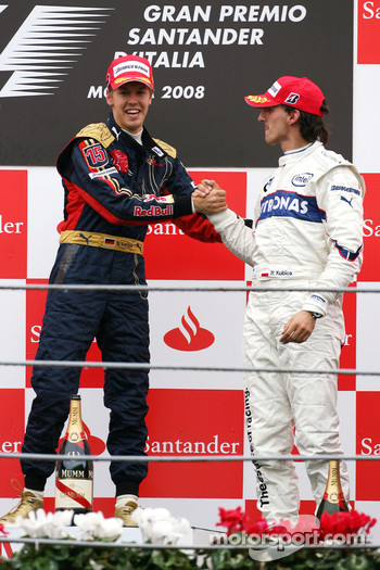 Podium: race winner Sebastian Vettel celebrates with Robert Kubica