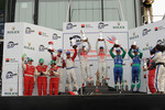 LMP1 podium: class and overall winners Allan McNish and Rinaldo Capello, second place Jan Charouz and Stefan Mücke, third place Jean-Christophe Boullion and Romain Dumas, best private team Jan Lammers, Didier Theys and Fredy Lienhard