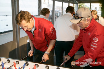 Ralf Jttner and Rinaldo Capello play fussball at the Audi Sport Team Joest hospitality