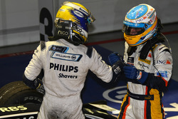 Race winner Fernando Alonso celebrates with Nico Rosberg
