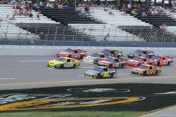 Tony Stewart and Jimmie Johnson lead a group of cars