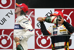 Podium: champagne for Robert Kubica and Fernando Alonso