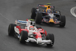 Timo Glock, Toyota F1 Team, TF108 and Mark Webber, Red Bull Racing, RB4