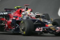 Lewis Hamilton, McLaren Mercedes, MP4-23 and Sebastian Vettel, Scuderia Toro Rosso, STR03