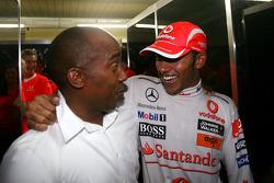 2008 World Champion Lewis Hamilton celebrates with his father Anthony Hamilton
