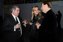 PRN's Steve Richards talks with Debby Robinson and ESPN.com's David Newton during Sprint's reception at the Sports Museum of American